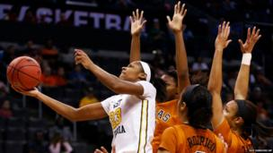West Virginia guard Bria Holmes shoots in front of Texas players