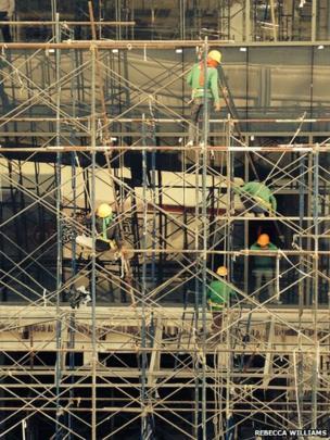 Workers on scaffolding in Bangkok
