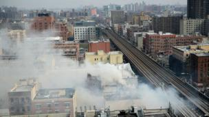 Smoke fills the sky above Harlem after a fire broke out in the building