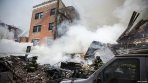 Firefighters search the rubble shortly after the explosion