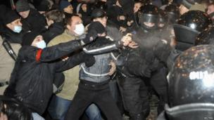 Police separate participants of anti-war (left) and pro-Russian rallies as they clash in Donetsk, 13 March