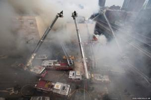 New York City firefighters work at the site of a building explosion and collapse