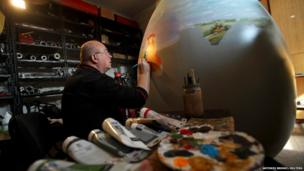 A local artist paints a 2m high Easter egg in the Croatian town of Koprivnica