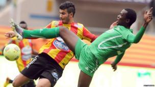 Esperance of Tunis (EST) striker Haythem Juini, left, and Kenya's Gor Mahia FC defender Musa Mohamed, Getty Images