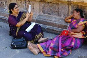 Woman photographs a friend