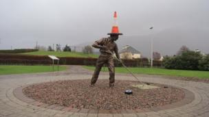 Statue wearing a traffic cone