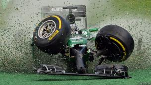 Caterham-Renault driver Kamui Kobayashi of Japan veers off the track during an accident at the start of the Formula 1 Australian Grand Prix in Melbourne