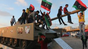 Boys playing on tank waving the Libyan flag, Benghazi, Libya - Wednesday 19 March 2014