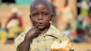A boy eating bread in Bondon in Kaduna state, Nigeria - Thursday 20 March 2014