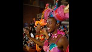 Dressed-up performers participate in the Cape Town Carnival, South Africa - Saturday 15 March 2014