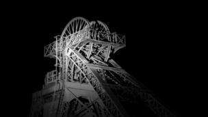 The pit head winding wheels at the Rhondda Heritage Park (formerly Lewis Merthyr Colliery), which is illuminated at night