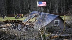 Rescue workers recover a body from the site of a landslide in Washington state