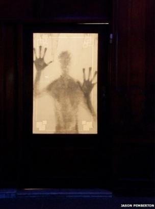 Shadow of a figure a door