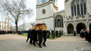 The coffin of former Labour cabinet minister Tony Benn is carried by members of his family
