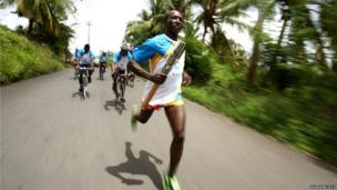 Long distance runner Caswin Prince runs with the baton in Kingstown, St. Vincent and the Grenadines.
