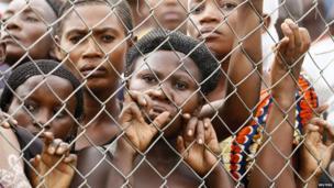 Relatives gather outside a morgue in Bundibugyo, Uganda, on 23 March 2014