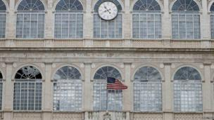 The US flag waves outside the Apostolic Palace during President Obama's audience with Pope Francis