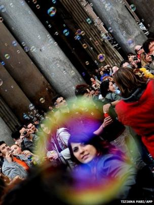 Soap bubbles float away during a flash mob near the Pantheon in Rome