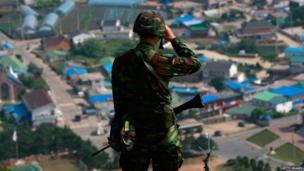 A South Korean marine looks through binoculars on Baengnyeong Island on 15 June, 2010
