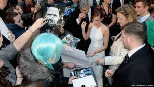 Actress Emma Watson signs autographs