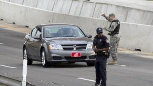 Vehicles are checked outside Fort Hood military base after the shooting there, 2 April