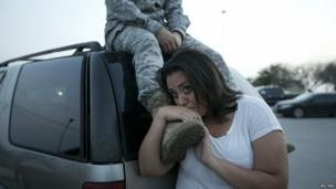 Luci Hamlin and her husband Specialist Timothy Hamlin wait to get back to their home on base at Fort Hood, Texas, 2 April