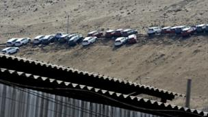 Cars parked on a hillside affected by a quake and aftershocks in Iquique - 3 April 2014