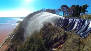 Engineers decided to create a controlled landslip there using high powered water cannons