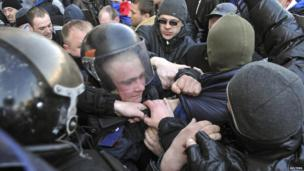 Pro-Russian activists scuffle with the police near the regional government building in Donetsk on 6 April 2014