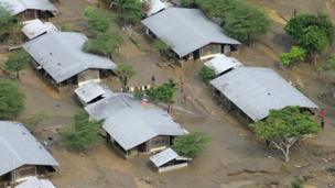 In this Saturday, 5 April, 2014 photo, buildings are surrounded by mud and flood waters on the Guadalcanal Plains, Solomon Islands