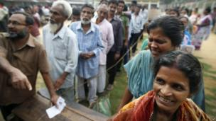 People stand in line to cast their votes during the first phase of elections in Agartala, Tripura