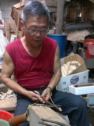 A worker at Mr Lin's factory
