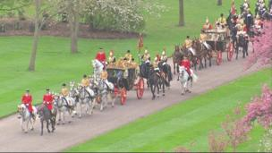 A procession of horses and carriages