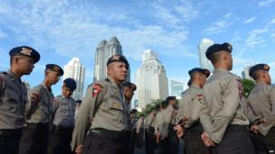Indonesian policemen attend a roll call for upcoming legislative elections at the Jakarta police headquarters in Jakarta on 7 April, 2014