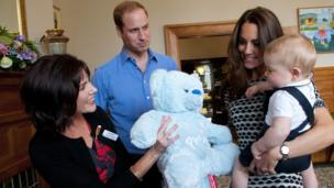 Prince George with his parents the Duke and Duchess of Cambridge