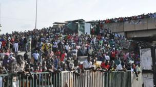 People gathered at the scene of an explosion at a bus park in Abuja, Nigeria, Monday, on 14 April 2014.