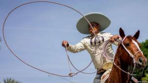 Over in America this cowboy shows off his lasso skills during a traditional Easter Sunday parade in Los Angeles.