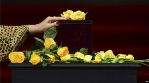 A woman touches the urn containing his ashes of Gabriel Garcia Marquez in Mexico City, April 21, 2014.