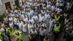 People take part in a symbolic funeral in Aracataca, Colombia, April 21, 2014.