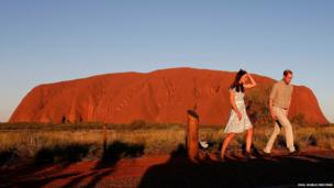 The Duke and Duchess of Cambridge in front of the Uluru, also known as Ayers Rock