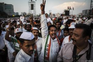 """A supporter of India""""s ruling Congress Party shouts slogans during a rally on April 20, 2014 in Mumbai, India"""