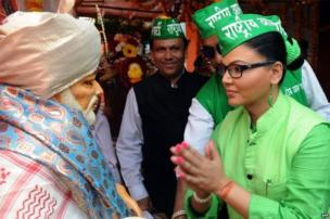 Indian Bollywood actress and Rashtriya Aam Party candidate Rakhi Sawant seeks blessings at a temple while campaigning in Mumbai