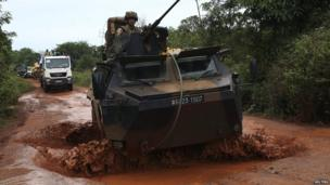 A French armoured vehicle driving through mud in CAR - Sunday 20 April 2014