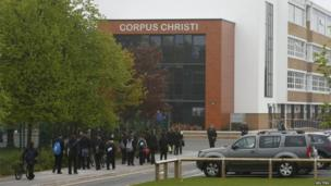 Pupils arrive at Corpus Christi Catholic College where teacher Ann Maguire was fatally stabbed in Leeds