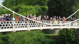 Onlookers on the bridge