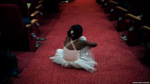 A girl waits to celebrate International Dance Day