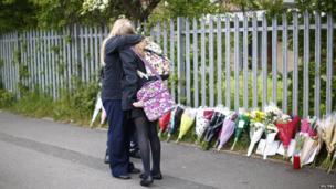 Tribute scene outside the school