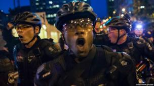 "Police yell ""get back"" to crowds of people during an anti-capitalist demonstration in Seattle, Washington"