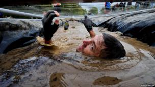 Racers go through freezing cold water in the Tough Mudder race