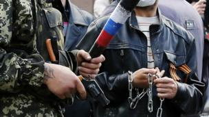 Armed pro-Russian activists look on during clashes with supporters of the Kiev government in the streets of Odessa May 2, 2014